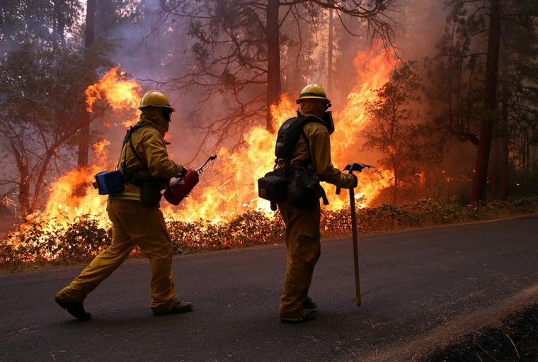 Firefighters from Ebbetts Pass Fire District monitor a back fire as they battle the Rim Fire on August 21, 2013 in Groveland, California. The Rim Fire continues to burn out of control and threatens 2,500 homes outside of Yosemite National Park. Over 400 firefighters are battling the blaze that is only 5 percent contained. (Justin Sullivan/Getty Images)