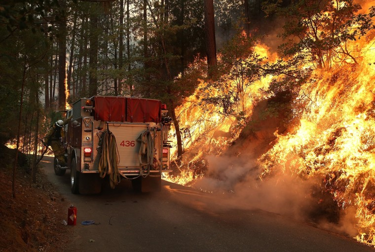 A firefighter from Ebbetts Pass Fire District monitors a back fire as he battles the Rim Fire on August 21, 2013 in Groveland, California. The Rim Fire continues to burn out of control and threatens 2,500 homes outside of Yosemite National Park. Over 400 firefighters are battling the blaze that is only 5 percent contained. (Justin Sullivan/Getty Images)