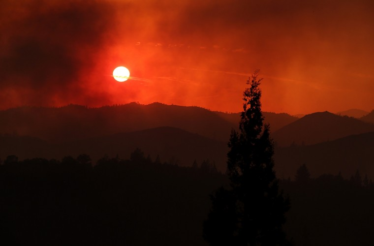 The sun sets through heavy smoke from the Rim Fire on August 21, 2013 in Groveland, California. The Rim Fire continues to burn out of control and threatens 2,500 homes outside of Yosemite National Park. Over 400 firefighters are battling the blaze that is only 5 percent contained. (Justin Sullivan/Getty Images)