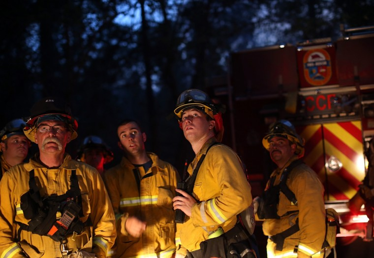 Firefighters from Ebbetts Pass Fire District monitor a back fire while battling the Rim Fire on August 21, 2013 in Groveland, California. The Rim Fire continues to burn out of control and threatens 2,500 homes outside of Yosemite National Park. Over 400 firefighters are battling the blaze that is only 5 percent contained. (Justin Sullivan/Getty Images)