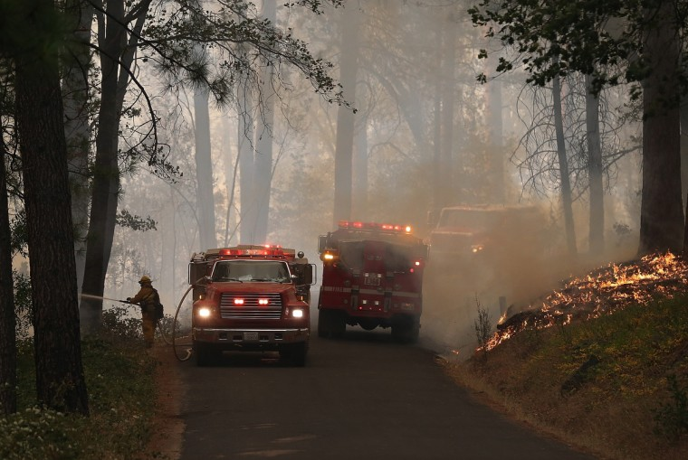 Firefighters monitor a back fire while battling the Rim Fire on August 21, 2013 in Groveland, California. The Rim Fire continues to burn out of control and threatens 2,500 homes outside of Yosemite National Park. Over 400 firefighters are battling the blaze that is only 5 percent contained. (Justin Sullivan/Getty Images)