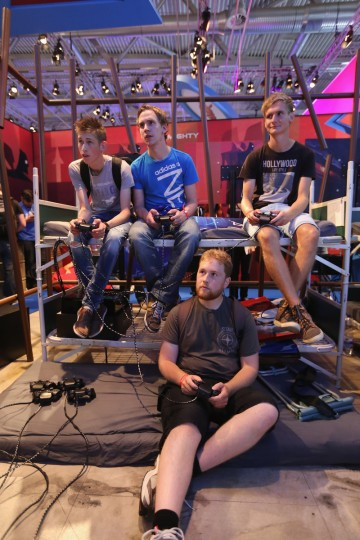 Gaming enthusiasts try out games on Sony Playstation at the Gamescom 2013 gaming trade air. (Juergen Schwarz/Getty Images)