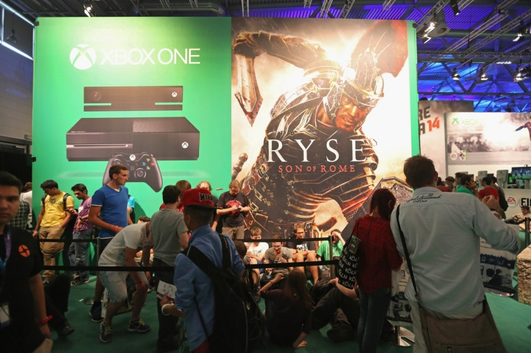 Gaming enthusiasts line up for the game RYSE: Son of Rome on the new XBOX at the Gamescom 2013 gaming trade air in Cologne, Germany. (Juergen Schwarz/Getty Images)