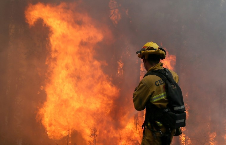 A firefighter from Central Calaveras Fire monitors the Rim Fire on August 22, 2013 in Groveland, California. The Rim Fire continues to burn out of control and threatens 2,500 homes outside of Yosemite National Park. Over 1,000 firefighters are battling the blaze that was reduced to only 2 percent containment after it nearly tripled in size overnight. (Justin Sullivan/Getty Images)