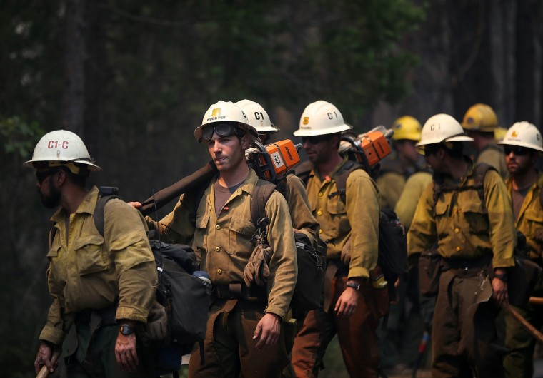 U.S. Forest Service firefighters move into position while battling the Rim Fire on August 22, 2013 in Groveland, California. The Rim Fire continues to burn out of control and threatens 2,500 homes outside of Yosemite National Park. Over 1,000 firefighters are battling the blaze that was reduced to only 2 percent containment after it nearly tripled in size overnight. (Justin Sullivan/Getty Images)
