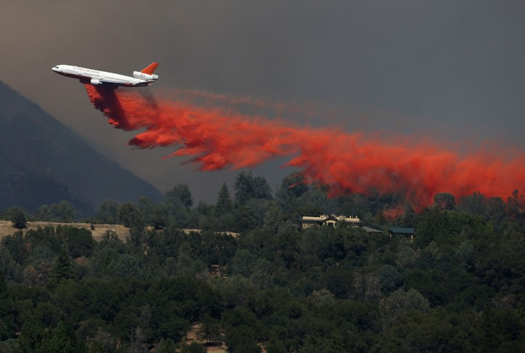 A DC-10 air tanker drops fire retardant on a ridge ahead of the advancing Rim Fire on August 22, 2013 in Groveland, California. The Rim Fire continues to burn out of control and threatens 2,500 homes outside of Yosemite National Park. (Justin Sullivan/Getty Images)