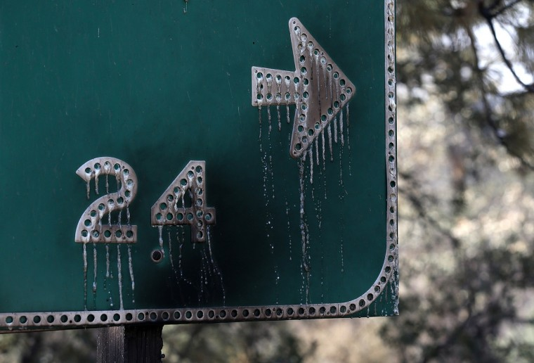 Letters on a road sign are seen melted after being burned by the Rim Fire on August 23, 2013 near Groveland, California. (Justin Sullivan/Getty Images)