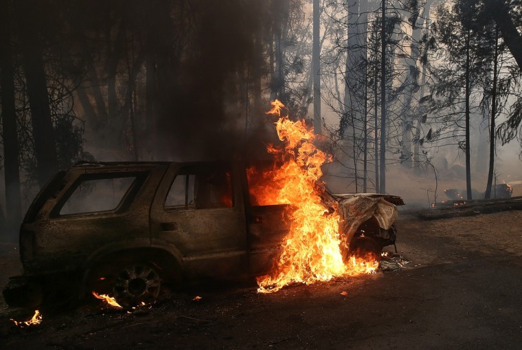 Flames billow from the front of a car that was consumed by the Rim Fire on August 25, 2013 near Groveland, California. (Justin Sullivan/Getty Images)