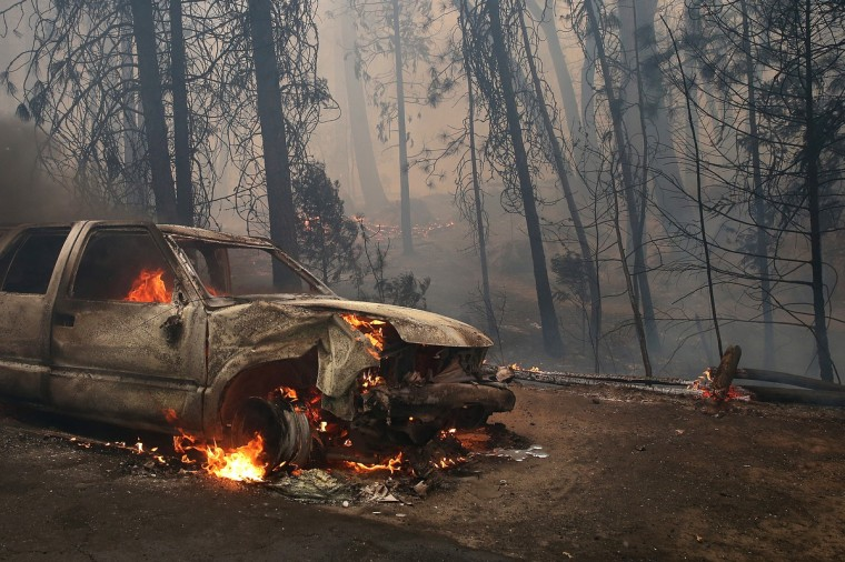 A burned car sits on the side of the road after being consumed by the Rim Fire on August 25, 2013 near Groveland, California. (Justin Sullivan/Getty Images)
