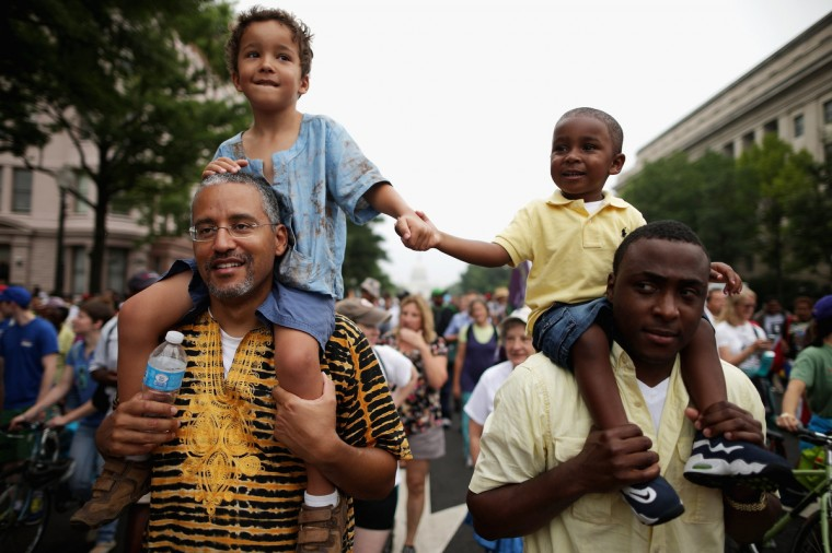 "(L-R) John Mbugua and his son Giovanni Mbugua, 6, of San Jose, California, and Lavon Johnson and his son Mason Johnson, 2, of Fort Meade Maryland, hold hands while marching with thousands of other people from Capitol Hill to the Lincoln Memorial during the 'Let Freedom Ring Commemoration and Call to Action' honoring the 50th anniversary of the historic March on Washington for Jobs and Freedom August 28, 2013 in Washington, DC. The 1963 landmark civil rights event was where Dr. Martin Luther King Jr. delivered his famous speech, saying, 'I still have a dream, a dream deeply rooted in the American dream...one day this nation will rise up and live up to its creed, ""We hold these truths to be self evident: that all men are created equal."" I have a dream . . .' (Chip Somodevilla/Getty Images)"