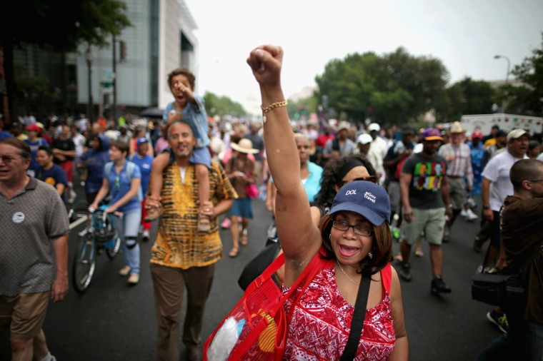 Joyce Elliotte of Temple Hills, Maryland, joins thousands of people as they march from Capitol Hill to the Lincoln Memorial during the 'Let Freedom Ring Commemoration and Call to Action' honoring the 50th anniversary of the historic March on Washington for Jobs and Freedom August 28, 2013 in Washington, DC. (Chip Somodevilla/Getty Images)