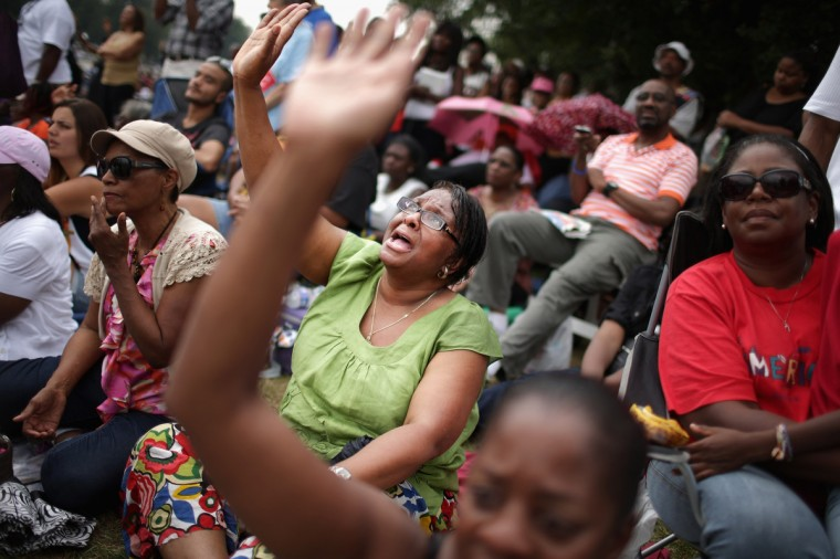 People cheer and pray during the 'Let Freedom Ring Commemoration and Call to Action' honoring the 50th anniversary of the historic March on Washington for Jobs and Freedom on the National Mall August 28, 2013 in Washington, DC. (Chip Somodevilla/Getty Images)