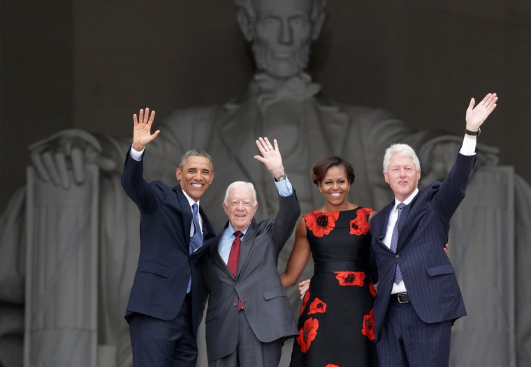 "U.S. President Barack Obama, former president Jimmy Carter, first lady Michelle Obama, and former president Bill Clinton wave as they leave at the end of the Let Freedom Ring ceremony at the Lincoln Memorial August 28, 2013 in Washington, DC. The event was to commemorate the 50th anniversary of Dr. Martin Luther King Jr.'s ""I Have a Dream"" speech and the March on Washington for Jobs and Freedom. (Alex Wong/Getty Images)"