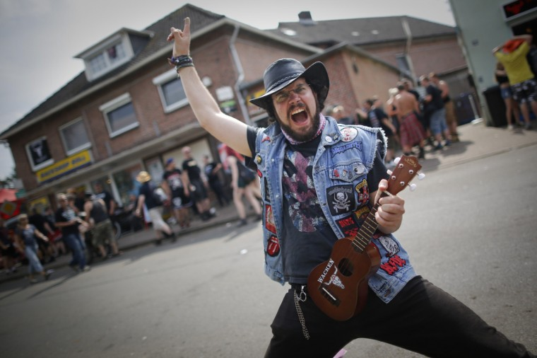 Metal-fan David poses with his ukulele during the Wacken Open Air Festival 2013 in Wacken, Germany. (Philipp Guelland/Getty Images)