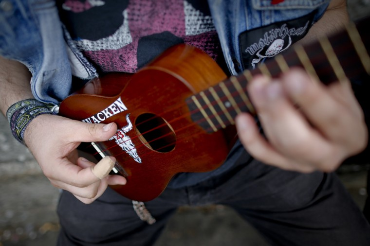 Metal-fan David plays his ukulele during the Wacken Open Air Festival 2013 in Wacken, Germany. (Philipp Guelland/Getty Images)