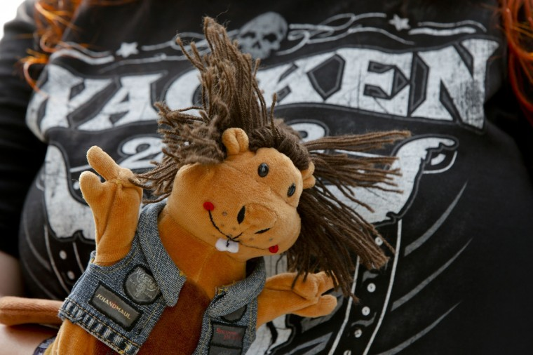 A participant of the 24th heavy metal Wacken Open Air (WOA) Festival 2013 shows his soft toy in Wacken, northern Germany. (Philipp Guelland/Getty Images)
