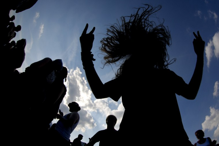A reveller is silhouetted while headbanging during the 24th heavy metal Wacken Open Air (WOA) Festival 2013 in Wacken, northern Germany on August 1, 2013. With some 80,000 festival visitors it attracts all kinds of metal music fans, such as fans of black metal, death metal, power metal, thrash metal, gothic metal, folk metal and even metalcore, nu metal and hard rock from around the world. (Philipp Guelland/Getty Images)