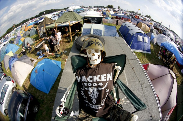 A costumed skeleton sits on the roof of a camper during the 24th heavy metal Wacken Open Air (WOA) Festival 2013 in Wacken, northern Germany. (Philipp Guelland/Getty Images)