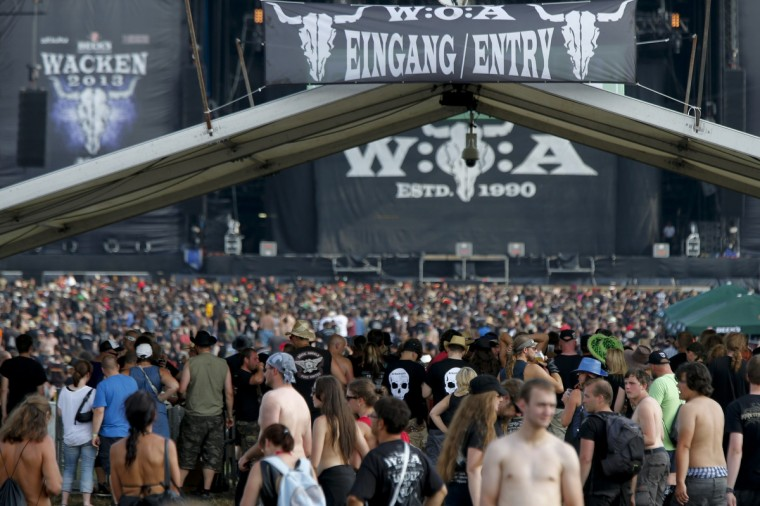 Revellers crowd the festival site during the 24th heavy metal Wacken Open Air (WOA) Festival 2013 in Wacken, northern Germany. (Philipp Guelland/Getty Images)