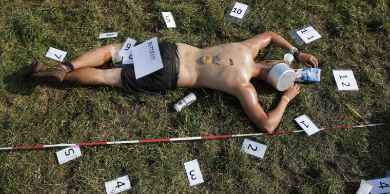 A reveller takes a nap during the 24th heavy metal Wacken Open Air (WOA) Festival 2013 in Wacken, northern Germany. (Philipp Guelland/Getty Images)
