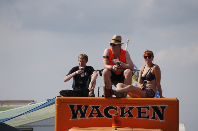 Revellers sit on their truck painted with the Wacken logo during the 24th heavy metal Wacken Open Air (WOA) Festival 2013 in Wacken, northern Germany. (Philipp Guelland/Getty Images)