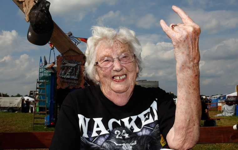 A 90-year-old heavy metal fan makes the rock hand-sign as she attends the 24th heavy metal Wacken Open Air (WOA) Festival 2013 in Wacken, northern Germany on August 1, 2013. With some 80,000 festival visitors it attracts all kinds of metal music fans, such as fans of black metal, death metal, power metal, thrash metal, gothic metal, folk metal and even metalcore, nu metal and hard rock from around the world. (Axel Heimken/Getty Images)