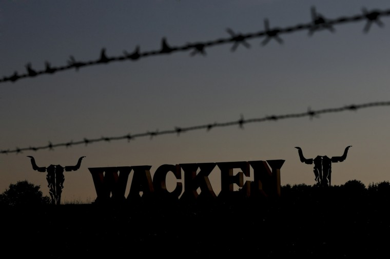 The festival's logo is silhouetted during the 24th heavy metal Wacken Open Air (WOA) Festival 2013 in Wacken, northern Germany on August 1, 2013. (Philipp Guelland/Getty Images)