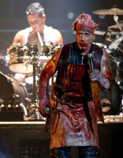 Til Lindemann of German rock bank Rammstein performs on stage during heavy metal Wacken Open Air (WOA) Festival 2013 in Wacken, northern Germany on August 1, 2013. With some 80,000 festival visitors it attracts all kinds of metal music fans, such as fans of black metal, death metal, power metal, thrash metal, gothic metal, folk metal and even metalcore, nu metal and hard rock from around the world. (Axel Heimken/Getty Images)