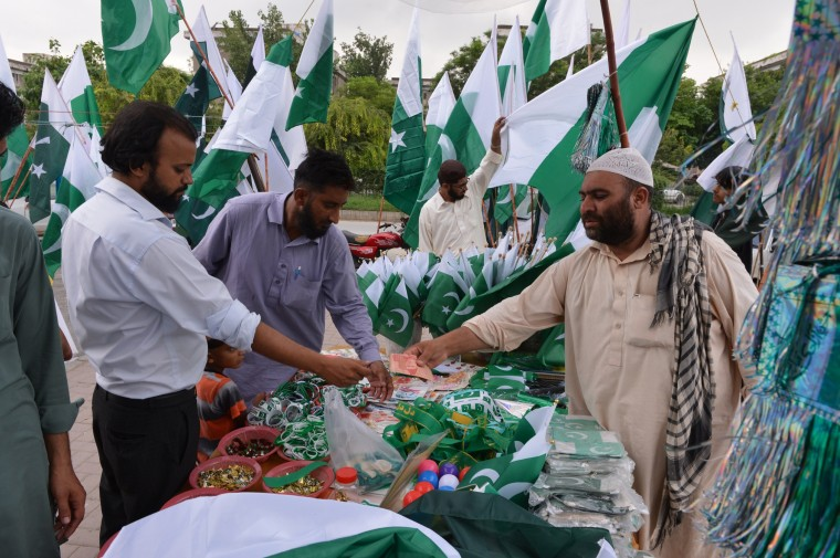 Pakistanis buy national flags at a roadside stall ahead of the country's Independence Day in Islamabad on August 12, 2013. Pakistan will be celebrating its 66th anniversary of the country's independence from British rule on August 14. (Amir Qureshia/AFP)