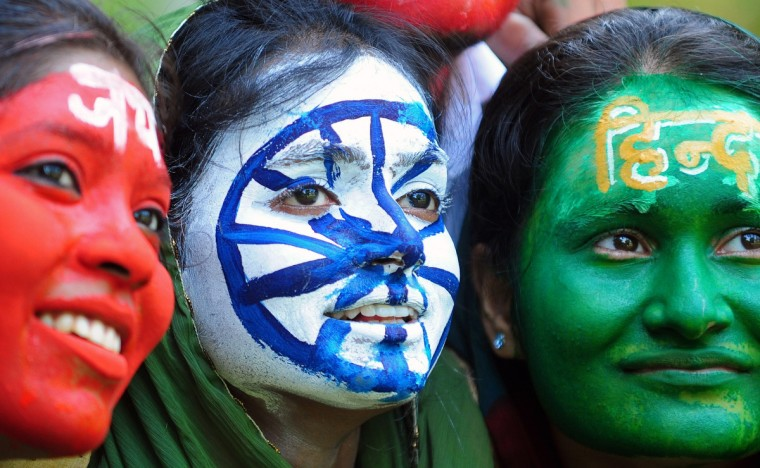 Indian students, their faces painted with the colors of their national flag, pose on the eve of Independence day in Allahabad on August 14, 2013. India celebrates its 66th independence anniversary from British rule on August 15. (Sanjay Kanojia/Getty Images)