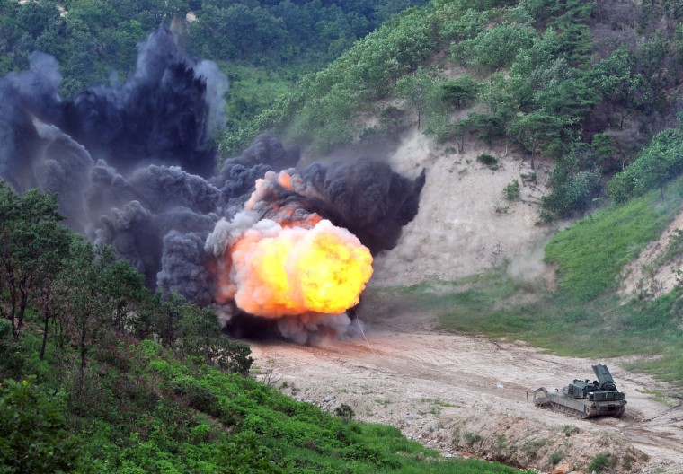 A US Army Assault Breacher Vehicle (ABV) fires the linear demolition charge system during a demonstration at Rodriguez Live Fire Complex in Pocheon, 65 kms northeast of Seoul. A total of six ABVs, a highly mobile and heavily armored minefield and complex obstacle clearing system, were dispatched to South Korea in this year. (Jung Yeon-Je/Getty Images)