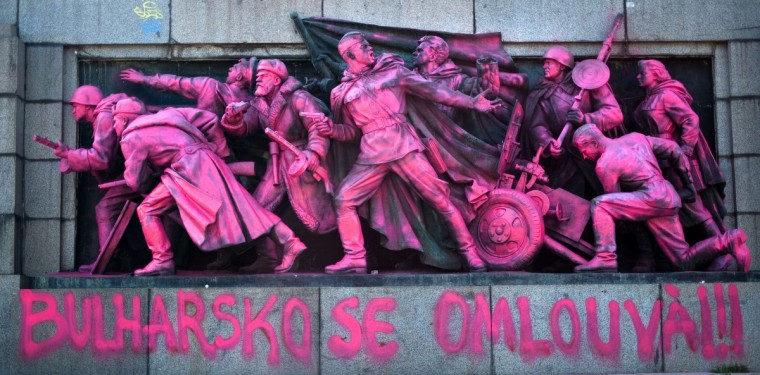 "The figures of Soviet soldiers at the base of the Soviet Army monument are seen painted by an unknown artist in cheeky pink facelift to decry the Warsaw Pact invasion of Czechoslovakia on August 20-21, 1968. The massive bronze relief sculpture depicting nine Soviet army soldiers was flamboyantly painted pink overnight and adorned with captions ""Prague '68"" and ""Bulgaria apologizes."" As part of the so-called Warsaw Pact, Bulgarian troops took part in the 1968 Soviet invasion of the former Czechoslovakia that crushed the Prague Spring reformist uprising in the country. (Dimitar Kilkoff/Getty Images)"