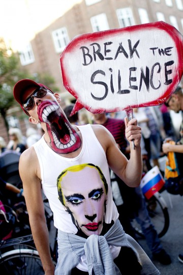 A demonstrator wears a t-shirt with a picture of a rouged Vladimir Putin as he takes part in a protest against the new Russian law on homosexuality in Copenhagen, Denmark. The protest march went from Christiansborg Castel to the Russian Embassy in Copenhagen. (Bax Lindhardt/Getty Images)