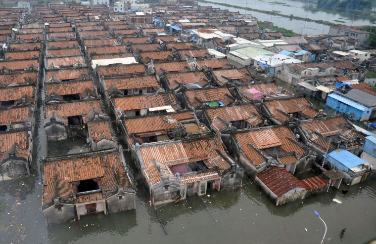This aerial view shows a residential area submerged by floodwaters in Shantou, in southern China's Guangdong province. The death toll from devastating floods at opposite ends of China following torrential rains and the aftermath of a typhoon has risen to more than 130, the government and media said on August 20. (Getty Images)