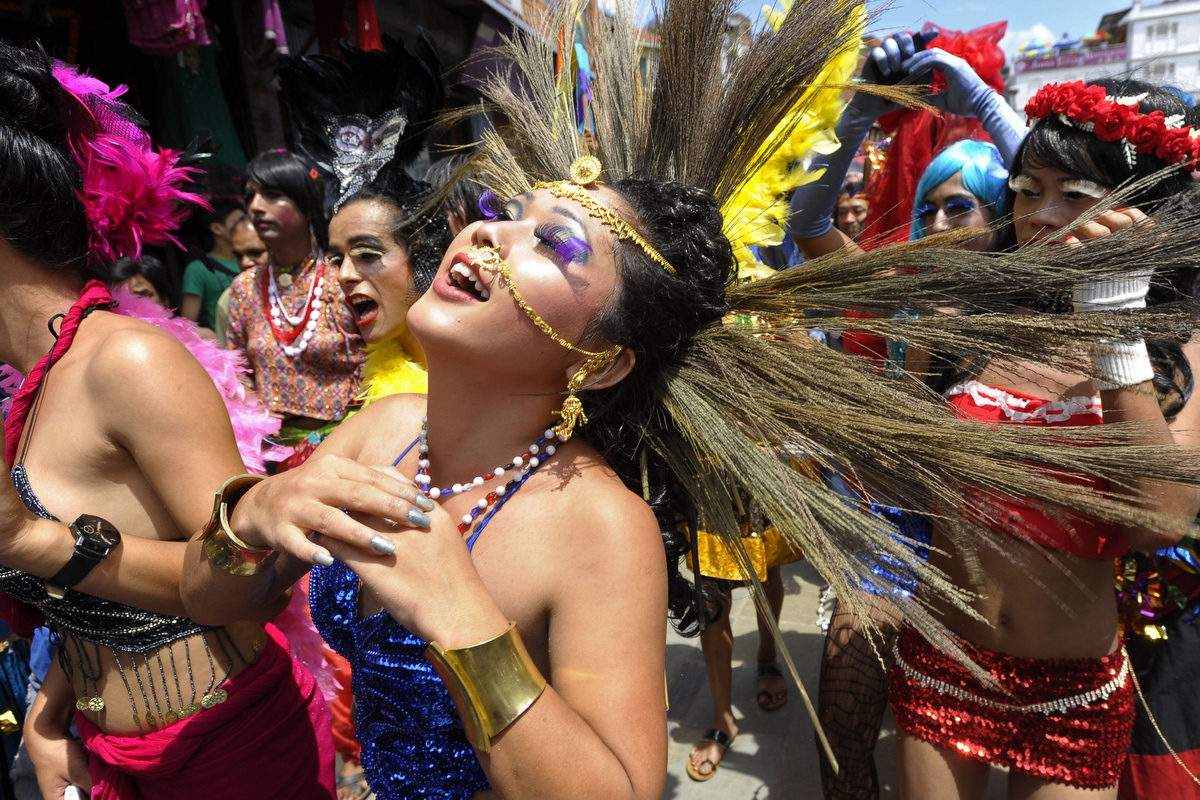August 22 Photo Brief: Nepal's Gay Pride parade, Ghost Festival in Hong Kong and crab races in Australia