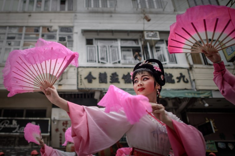 """Performers dance during a parade for the Hungry Ghost Festival in Hong Kong. The festival, celebrated in the seventh lunar month of the lunar new year calendar among communities in southern China, Malaysia, Singapore, Hong Kong and Taiwan, marks the belief that the """"Gates of Hell"""" are opened to let out the hungry ghosts who then wander in the land of the living while foraging for food. (Philippe Lopez/Getty Images)"""