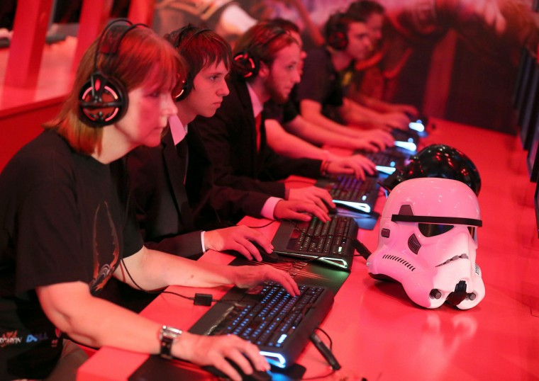 Computer games enthusiasts play during the gamescom fair in Cologne, western Germany. (Oliver Berg/Getty images)
