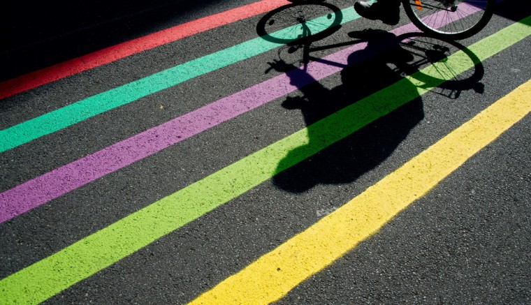 A man cycles a bike over painted lines at the trade fair centre where the Ideen Expo 2013 will take place in Hanover. The fair, opening on August 24, 2013, is organized for children, youth and young adults to arouse their spirit of research and to promote careers in the business of technique and natural sciences. (Julian Stratenschulte/Getty images)
