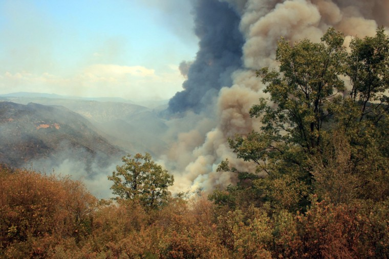 This photo obtained August 23, 2013 courtesy of the US Forest Service, shows the Rim Fire as it burns close to Groveland Ranger Station near Yosemite National Park, California. The wildfire outside Yosemite National Park, is one of more than 50 major brush blazes burning across the western United States , has more than tripled in size overnight and still threatens about 2,500 homes, hotels and camp buildings. Fire officials say that the blaze burning in remote, steep terrain has grown to more than 84 square miles (135 km) and was only 2 percent contained on August 22, 2013, down from 5 percent a day earlier. (Getty Images)