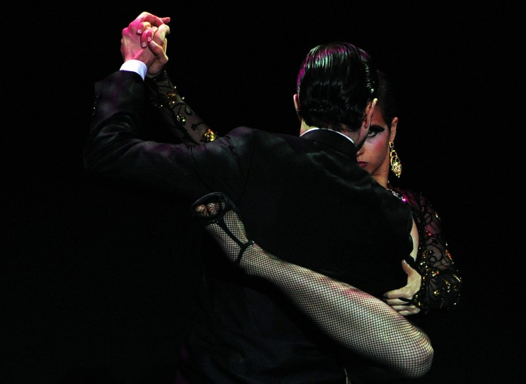 Colombia's dancers Juan David Bedoya Marin and Karla Rotavinsky Cadavid dance tango during the Stage Tango competition of the Tango World Championship in Buenos Aires. Daniel Garcia/Getty Images)