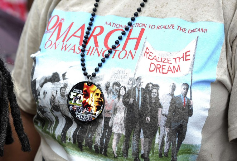 """The T-shirt of a woman is pictured as people brave light rain near at the Lincoln Memorial in Washington, DC, on August 28, 2013 to commemorate the 50th anniversary on the March on Washington, the civil rights watershed where Martin Luther King Jr famously declared: """"I have a dream."""" The March on Washington is best remembered for King's stirring vision of a United States free of inequality and prejudice, telecast live to a nation undergoing a phenomenal decade of soul-searching, crisis and change. (Jewel Samad/Getty Images)"""