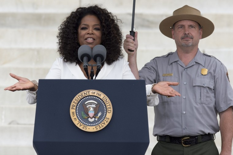 """Oprah Winfrey speaks during the Let Freedom Ring Commemoration and Call to Action to commemorate the 50th anniversary of the March on Washington for Jobs and Freedom at the Lincoln Memorial in Washington, DC on August 28, 2013. Thousands will gather on the mall on the anniversary of the march and Dr. Martin Luther King, Jr.'s famous """"I Have a Dream"""" speech. (Saul Loeb/Getty Images)"""