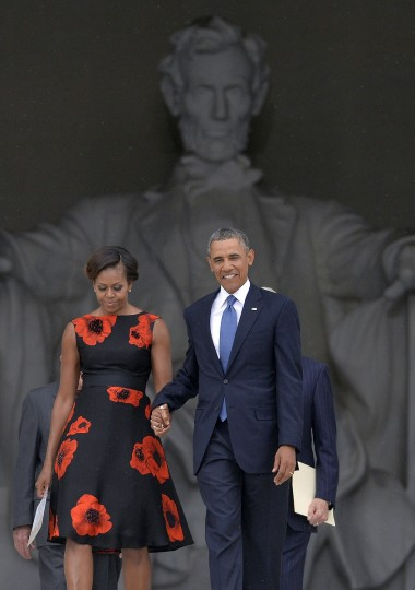 US President Barack Obama, First Lady Michelle Obama, former president Jimmy Carter and Bill Clinton arrive during the Let Freedom Ring Commemoration and Call to Action to commemorate the 50th anniversary of the March on Washington for Jobs and Freedom at the Lincoln Memorial in Washington, DC. (Jewel Samad/Getty Images)