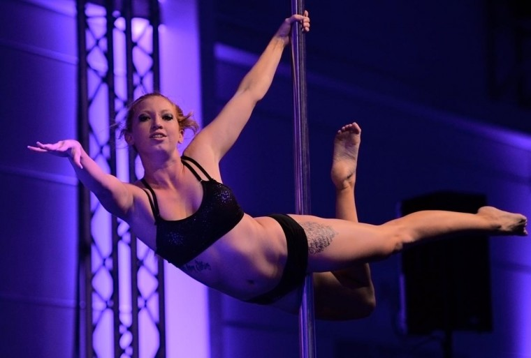 Samantha Peyke performs in the 2013 German Pole Dancing Championships on August 3, 2013 in Frankfurt, Germany. Thirty-four candidates, including six men and three children, competed in the event. (Thomas Lohnes/Getty Images)