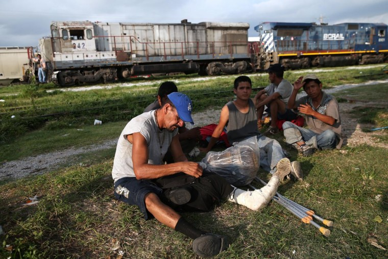 Central American immigrants prepare to board on a freight train headed north on August 3, 2013 in Arriaga, Mexico. (John Moore/Getty Images)