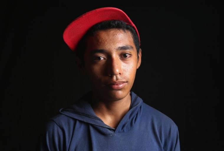 Guatemalan immigrant Javier, 14, spends a day at the Hermanos en el Camino immigrant shelter on August 5, 2013 in Ixtepec, Mexico. He said he planned to ride a freight train north later that night to continue his journey to the U.S. border and eventually to New Jersey. He said he wants to find work as an electrician, which has has been doing in Guatemala since he quit school at age 10 to help support his family. (John Moore/Getty Images)