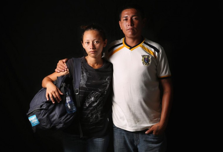 Genenis Yamileht, 20, and her husband Jose Natanael, 25, from El Salvador, spend a night at the Hermanos en el Camino immigrant shelter on August 5, 2013 in Ixtepec, Mexico. They said they planned to ride a freight train north the next night as part of their journey to the U.S. border and eventually to Houston, Texas., where he previously worked for 8 years. She said she is pregnant but hopes to get employment as a domestic worker, and he as a carpenter. (John Moore/Getty Images)