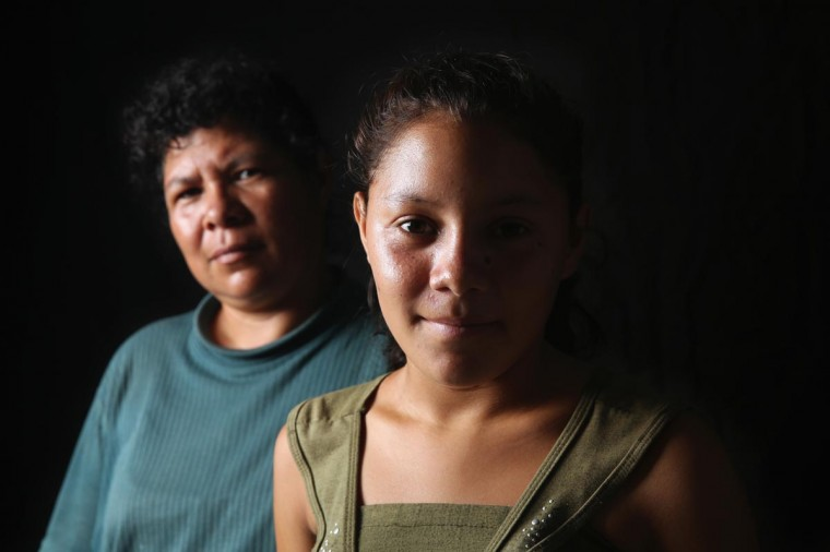 Salvadorian immigrant Consuelo Miscuita, 42, and her daughter Wendy, 15, spend another night at the Hermanos en el Camino immigrant shelter on August 5, 2013 in Ixtepec, Mexico. Consuelo said before arriving to the shelter they were robbed of all their money by Mexican federal police. They have been staying at the Hermanos shelter for four months while awaiting Mexican immigration documents to allow them to safely travel to the U.S. border by bus. Once there, they plan to meet up with Wendy's father, who is currently working in the northern state of Sonora, and then try to illegally cross together into the United States. The women are trying to avoid riding the freight trains, known as 'la bestia', or the beast, as thousands of other Central Americans do on their long and perilous journey north through Mexico. (John Moore/Getty Images)