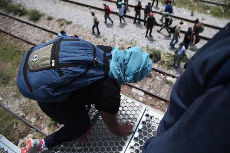Central American immigrants arrive on top of a freight train on August 6, 2013 to Ixtepec, Mexico. (John Moore/Getty Images)