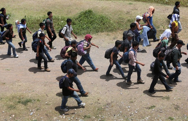 Central American immigrants walk after arriving atop a freight train for a stop on August 6, 2013 to Ixtepec, Mexico. (John Moore/Getty Images)